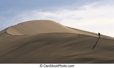 High Dune - With a huge sand dune wind blows the sand. The...