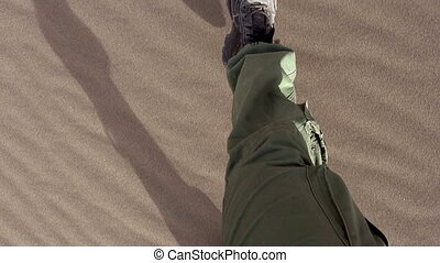 Running on Sand - Movement of the legs in the army gear on...