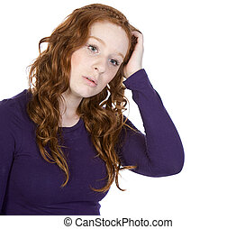 Shot of a Cute Red-Headed Teenager Scratching her Head