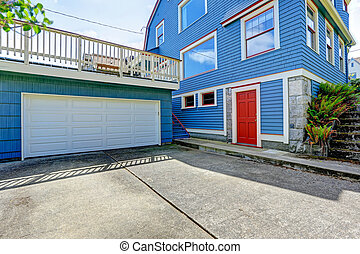 Garage with deck over it House exterior - Clapboard siding...
