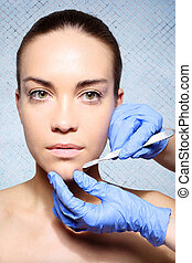 Scalpel, peeling, flaking - Plastic surgery, a woman in the...