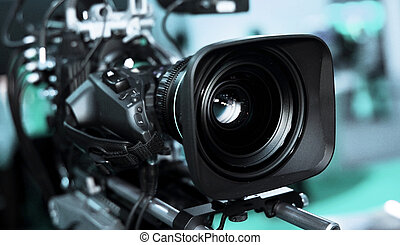 Camera video - Large professional black video camera filming...