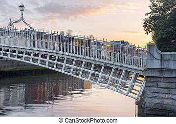 Hapenny Bridge over the Liffey River in Dublin, Ireland