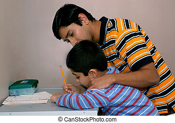 Teaching - Dad teaching his kid to do the homework