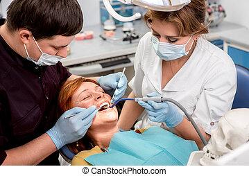 Senior woman on the dental operation. - Senior woman on the...
