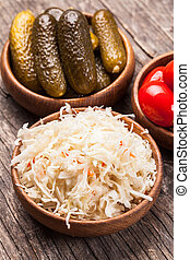pickled vegetables - Sauerkraut and pickled cucumbers and...