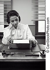 Young bored secretary typing