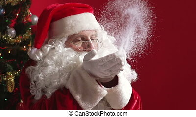 Kind of Magic - Santa Claus blowing glitter from his palms...