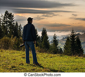 Man photographer in the mountains. - Man photographer in the...