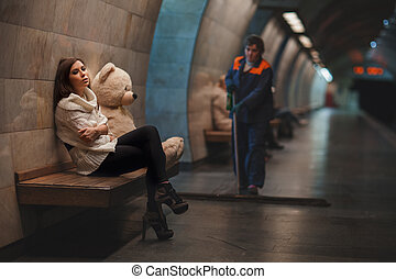 Beautiful and sad girl in the subway. - Beautiful and sad...