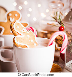 Christmas dessert - Cup of hot cocoa drink with cookie and...