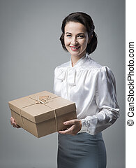 Smiling vintage woman with mail package - Smiling vintage...