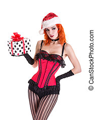 Beautiful pinup girl in red corset and Santa Claus hat, holding