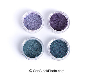 Mineral eye shadows in pastel colors, top view isolated on...