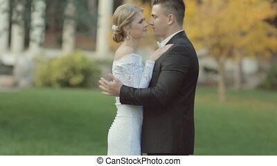 Wonderful newlyweds fooling around and laughing in the park...