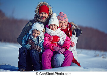 People in winterwear - Happy family of four in winterwear