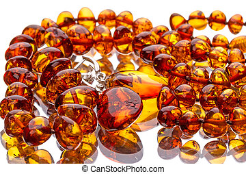 Amber necklace on the mirror isolated on white background