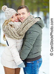 Couple in winterwear - Young amorous couple posing outdoors