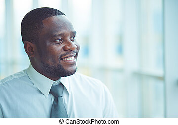 Office worker - Portrait of a businessman looking away