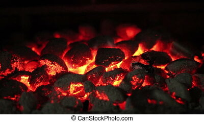 Glowing Coals - Hot sparking live-coals burning in a...