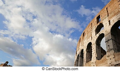 Coliseum view over the blue sky with clouds