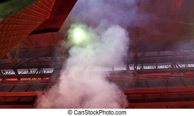 Smoky and hard working environment - Worker operates in...