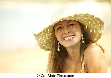Beautiful young woman smiling on the beach - Beautiful young...