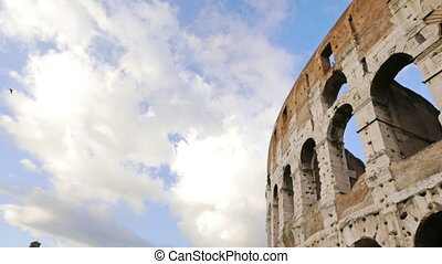Coliseum view over the blue sky with clouds, timelapse