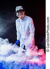 Smiling man scientist with dry ice
