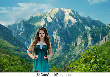 Beautiful girl enjoying valley view nature over mountain...