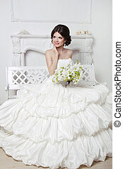 Beautiful attractive bride in wedding luxurious dress with...