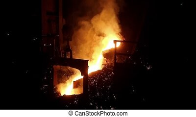 Molten steel pouring - Foundry, molten metal poured from...