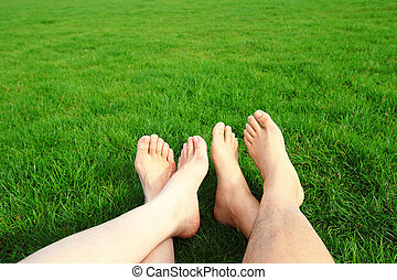 Couple Relax barefoot enjoy nature in the green lawn