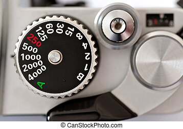 Detail of 35mm manual film camera, shutter speed dial