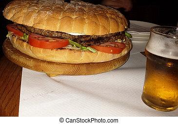 Huge double burger with beer