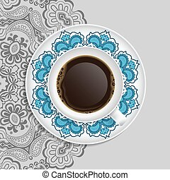 Cup of coffee and decorative ornament on a saucer and...