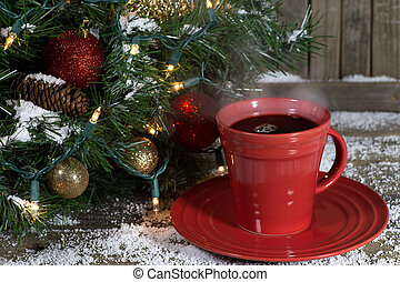 Cup of Steaming Coffee - Red cup of steaming coffee next to...
