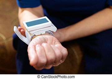 Blood pressure measuring. - Senior woman measuring blood...