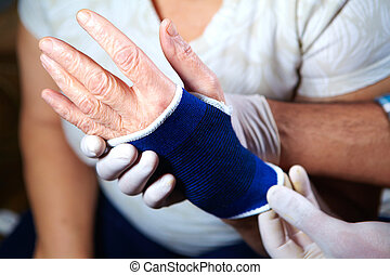 Hand of patient with bandage - Hand of patient old woman...