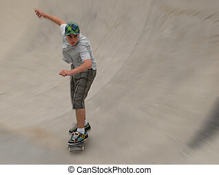 teenage skateboarder in half pipe with motion