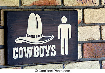 Cowboys toilet sign and symbol, concept photo copy space