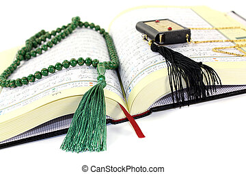 whipped Quran with green rosary