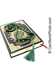 slammed Quran with green rosary