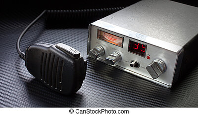 Citizen band radio - Old CB radio and microphone on a grey...