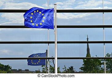 European union flag - European flag ahead of a glass facade...