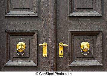 door knob - decorative door knob on old wooden brown doors