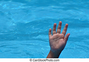 Hand of a drowning child in a swimming pool. Concept photo ....
