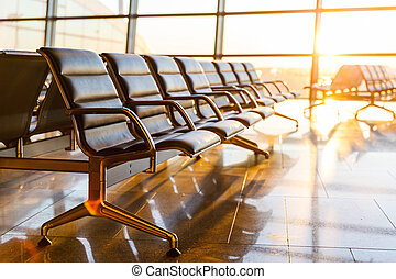 Empty departure lounge at the airport - Empty seats in the...