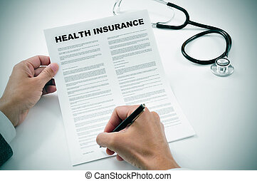 young man signing a health insurance policy
