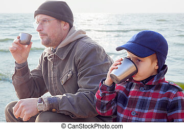 parent kid together drink tea coffee nature outdoor